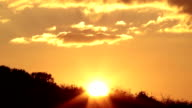 Close-up Heavenly sunset Time Lapse behind the mountain forest. 1080p video