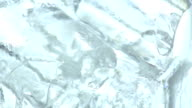 Closeup ice cube in glass and rotate video