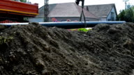Close-up Long Pipe Climb Down Into Earthen Trench video