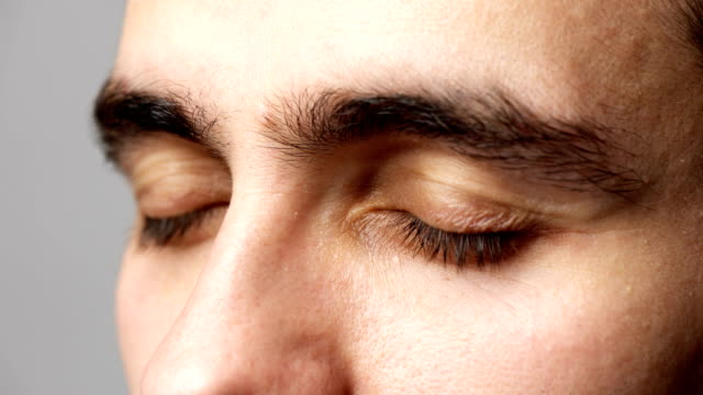 Close-up man eyes looking video