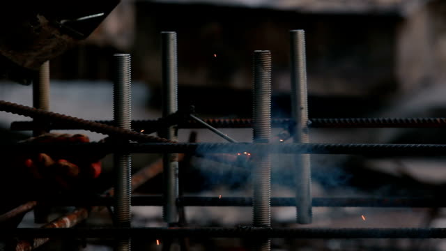 Close-up: man welding a pipe to the construction video