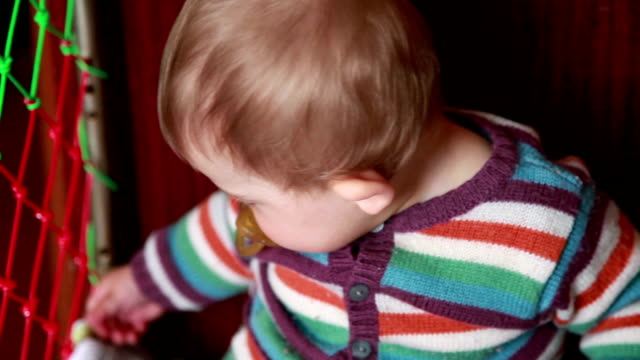 Close-up of a baby sitting in the crib video