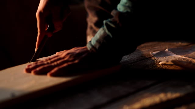 Close-up of a Carpenter working on a Wooden Window Frame with a File in his Workshop video