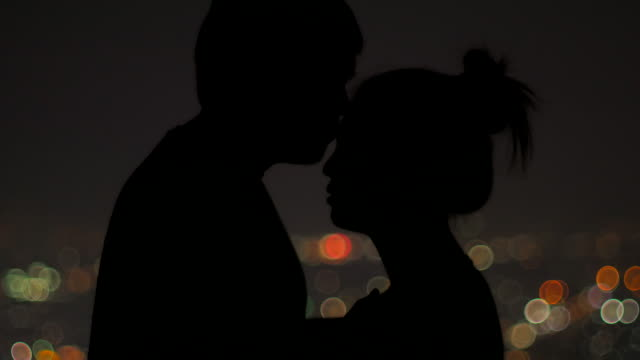 Close-up of a charming couple with bokeh background video