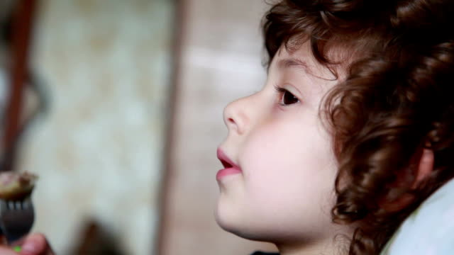 Close-up of a chewing little girl video