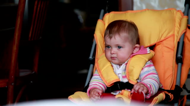 Close-up of a curious baby sitting in the pram video