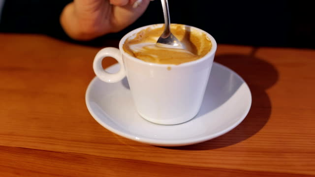 Close-up of a female hand with a Cup of cappuccino video