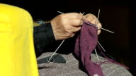 Closeup of a Grandmother Knitting Wool Socks on the Couch video