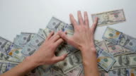 Close-up of a hand take out dollar bills. The concept of winning money video