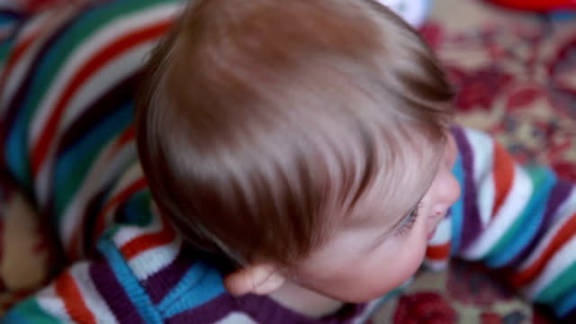 Close-up of a happy smiling baby looking at camera video