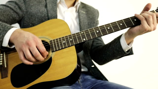 Close-up of a man playing an acoustic guitar. video