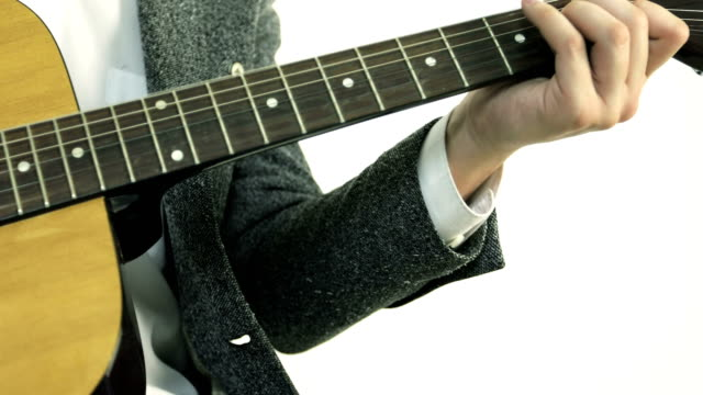 Close-up of a man's hand touches the strings on an acoustic guitar. video