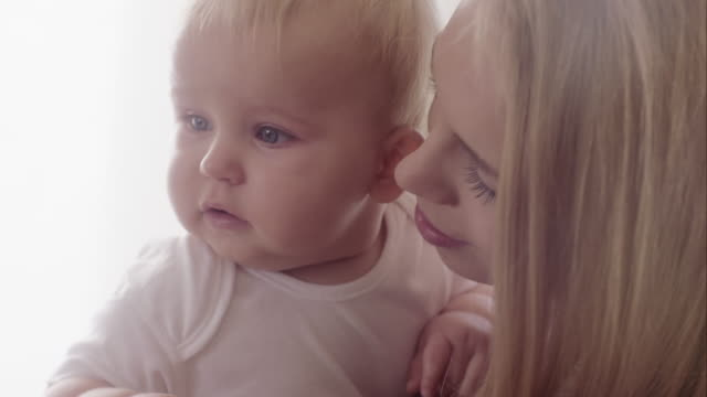 Close-up of a mother loving her baby video