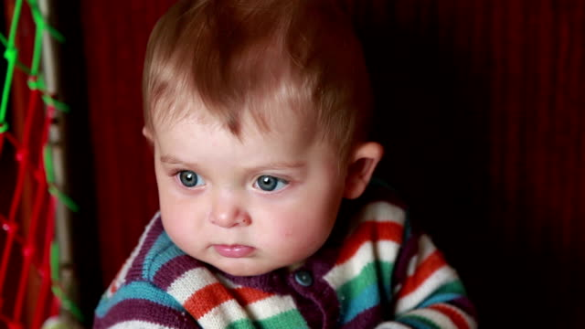 Close-up of a pensive baby girl video