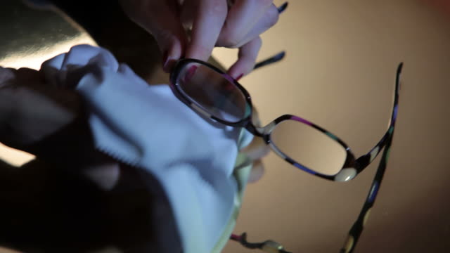 Close-up of a person cleaning her eyeglasses video