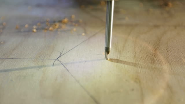 4K A close-up of a screwdriver makes holes in the chipboard. video