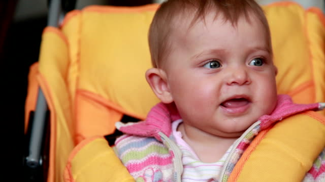 Close-up of a serious baby sitting in the pram video