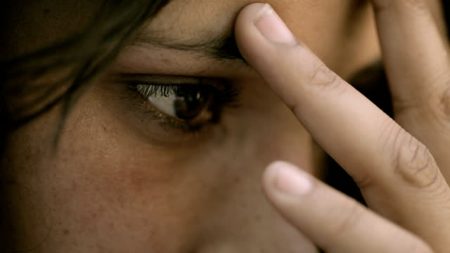 Close-up of a serious, young woman thinking deeply. video