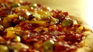 Close-up of a spinning pizza video