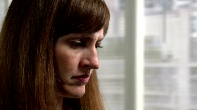 Close-up of a woman looking concerned video