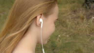 Close-up of a young woman with headphones video