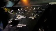 Closeup of aircraft flight control system, pilot's hand switching panel buttons video
