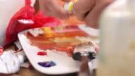 Closeup of artist preparing paint video