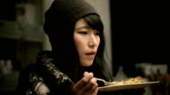 Close-up of Asian girl enjoying tasty and healthy food. video