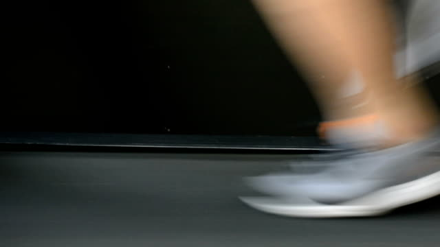 Closeup of athlete's feet running on treadmill video