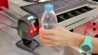 Close-up of Barcode scanner at shopping cash register,Supermarket store video