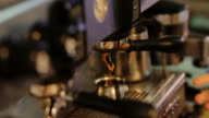 Closeup of barista working at coffee machine. Pour cacao in a cup. video