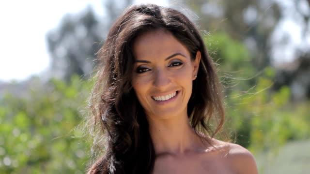 Closeup of beautiful woman smiling at camera. video