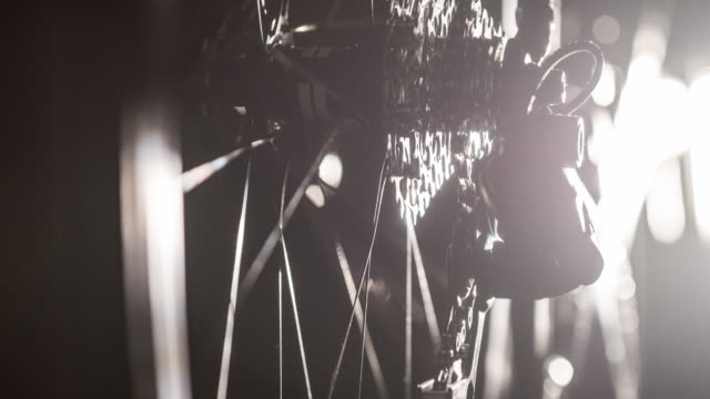 Close-up of bicycle gear and chain on black background video