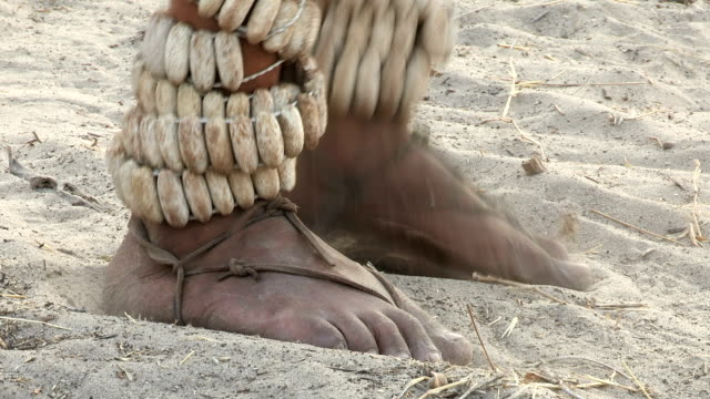 Close-up of Bushmen feet dancing rattles video
