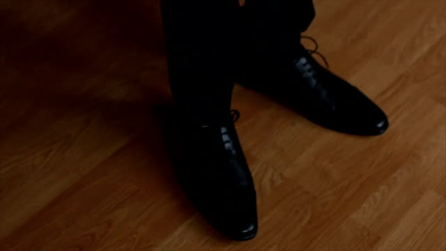 Close-up of businessman feet in black boots video