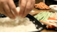 Close-up of chef hands cooking and preparing Asian food and sushi in restaurant kitchen. video