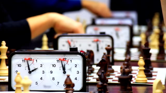 Close-up of chess game tournament with clock. Time lapse video