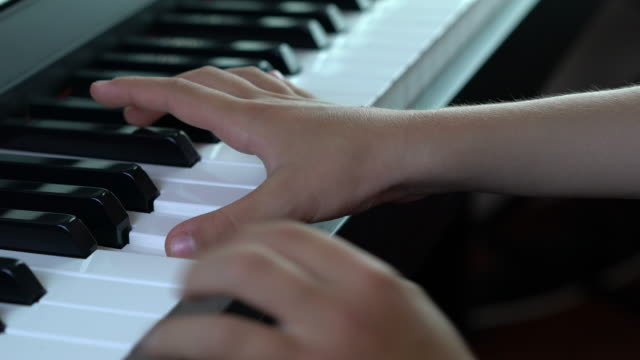 Close-up of child playing a piano video