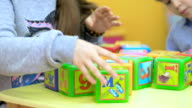 Close-up of children playing with cubes video