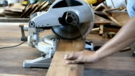 closeup of circular saw for cut wood plank video
