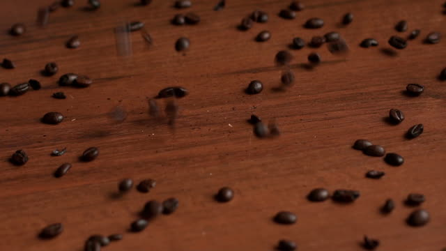 Close-up of coffee beans falling on the table. video