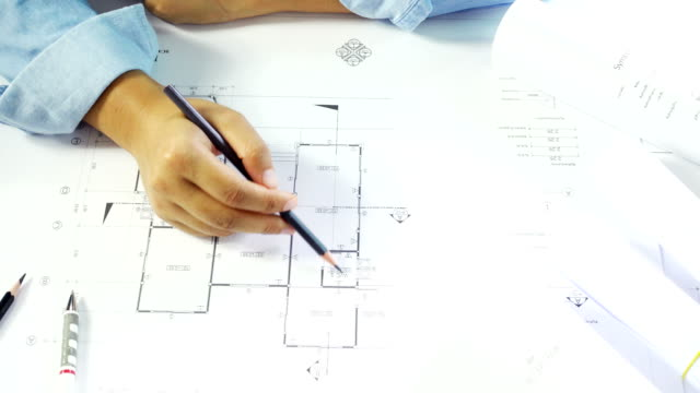 Close-up of confident architect female in casual wear working on desk video