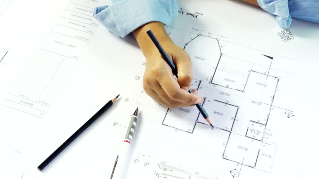 Close-up of confident architect female in casual wear working on desk. Concept building on project. video
