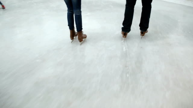 Closeup of couples feet ice skating video