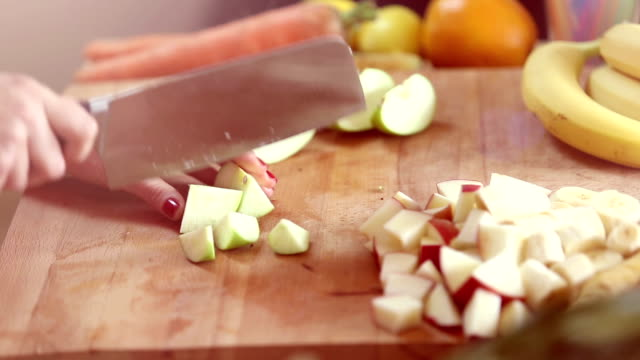 Close-up of cutting apple with knife video