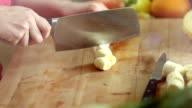 Close-up of cutting peeled banana with knife video
