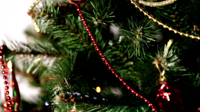 Close-up of ecorated Christmas tree with toys. Concept of New Year eve. video