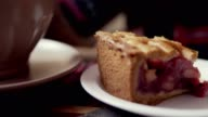 Close-up of female hands, tea and slice of pie. Woman eating cake in cafe video