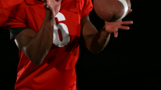 Closeup of football receiver catching in ball and running video