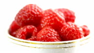 Closeup of  fresh raspberry in cup video
